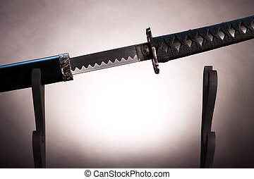 Katana on stand with partially drawn blade, - Almost black...