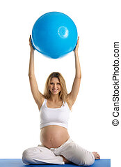 Pregnant woman practicing yoga with ball isolated on white