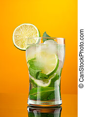 Mojito cocktail on yellow background