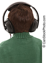 Child Wearing Head phones With Back Turned With Clipping...