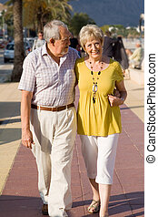 active seniors walking on vacation in mallorca