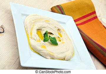 hummus - white plate with fresh hummus libanese food