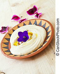 hummus - ceramic plate with fresh hummus libanese food