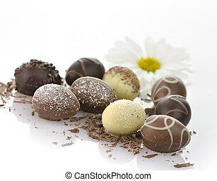 chocolate eggs - assortment of chocolate eggs on white...