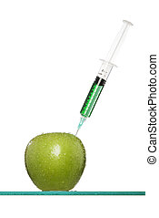 Syringes stuck in an apple - Syringes stuck in apple against...