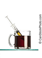 syringe in a cup of coffee on white