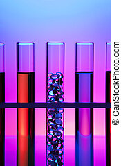 test tubes - Test tubes filled with colored fluid, one...