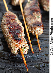 Lamb Kofta on a grill plate vertical - Vertical view of...