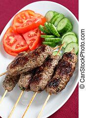 Arab lamb kofta on a plate vertical - Vertical view of a...