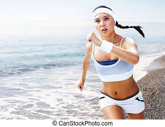 Marathon - A young woman running near the sea
