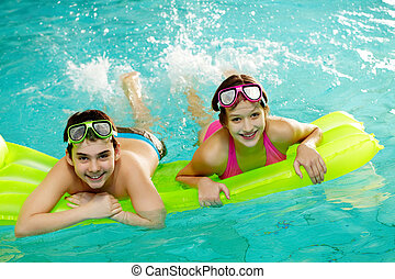 Fun - Photo of happy teenage friends swimming in pool