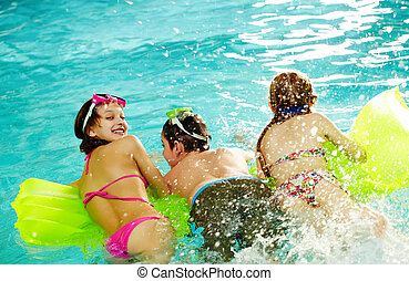 Joy - Photo of happy friends splashing water swimming in...
