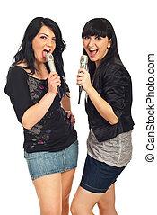 Modern females singing in microphones - Modern brunette...