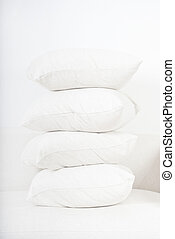 pillows - pile of white pillows on sofa