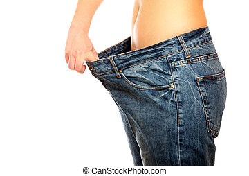 Weight loss - A picture of a young slim woman in oversized...