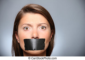 Be quiet! - A picture of a young girl with her lips covered...