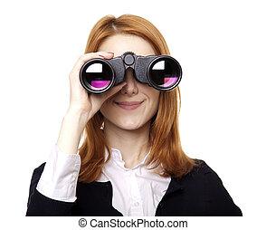 Business women seeking with binocular. Studio shot.