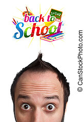 Young man with BACK TO SCHOOL sign over his head
