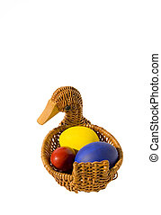three isolated color Easter eggs in basket