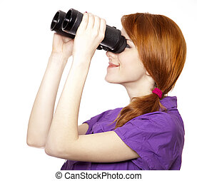 Teen red-haired girl with binoculars isolated on white...