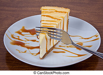 Caramel Drizzled Cheesecake on a Plate - Cheesecake With...