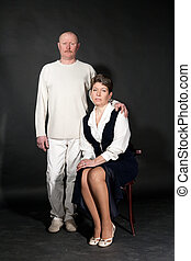 Old-fashion studio portrait of mid-aged couple