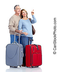 Senior couple travelers with bags Isolated over white...