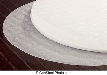 Rice Paper - White rice paper on a wooden table.