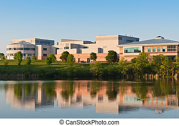 Community Center Building Reflected in a Pond