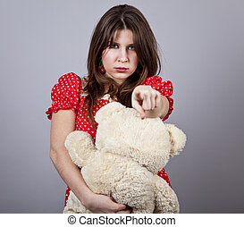 Funny girl with teddy bear Studio shot