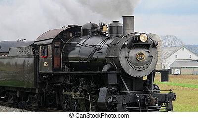 Steam Engine Close - A working railroad steam engine riding...