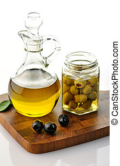olive oil - A bottle of olive oil with olives