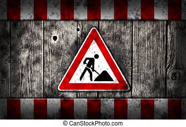 man at work - men at work roadsign on wooden aged background
