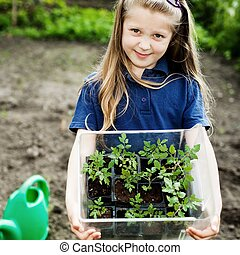 Girl with seedlings - An image of a nice little girl with...