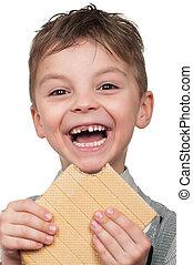 Boy with a waffle - Portrait of a cute boy having a waffle -...