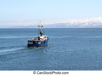 Fishing boat heading out to sea - Alaskan commercial fishing...