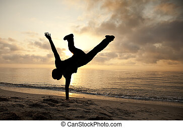 Cartwheel on the sunset