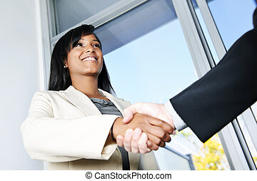 Business woman shaking hands - Portrait of black business...