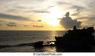 Tanah Lot - Time lapse sunset over Bali ocean at famous Sea...