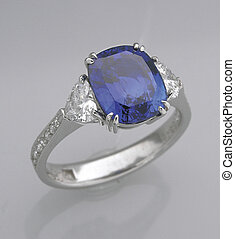 Ring. - A sapphire ring on the table.