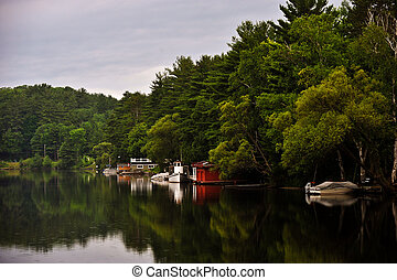 Water Reflections - Reflection of cottages, docks, boats &...