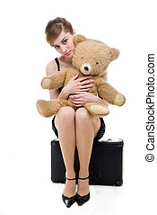 Sadness - An image of a sad woman with a teddy-bear