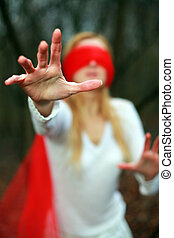 Red blindfold - An image of young woman with red blindfold...
