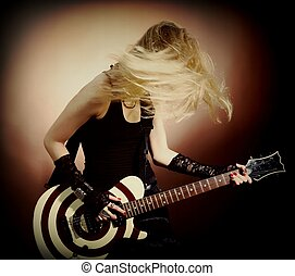 Woman with guitar - An image of a young woman with guitar