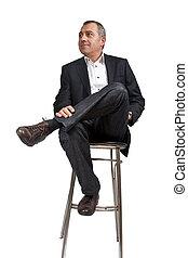Man on pub chair - Man sitting on a pub chair