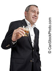 Man and alcohol - Man holding a whiskey glass