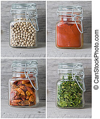 Spices in jars. - Glass jars with spices on an old wooden...