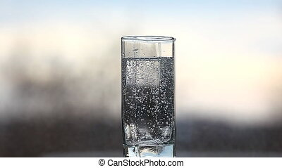 gas water with soda tablet and bubbles