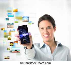 Streaming mobile phone - Business girl with streaming mobile...