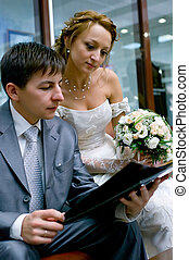 bride and groom reading the magazine